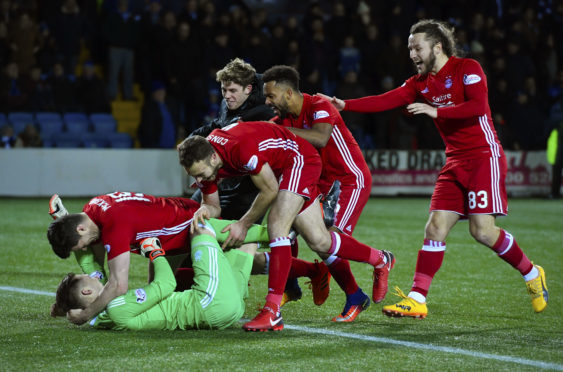 Aberdeen's players celebrate at the end of the shoot-out.