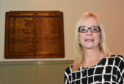 Jenny Cranna with one of the honour boards