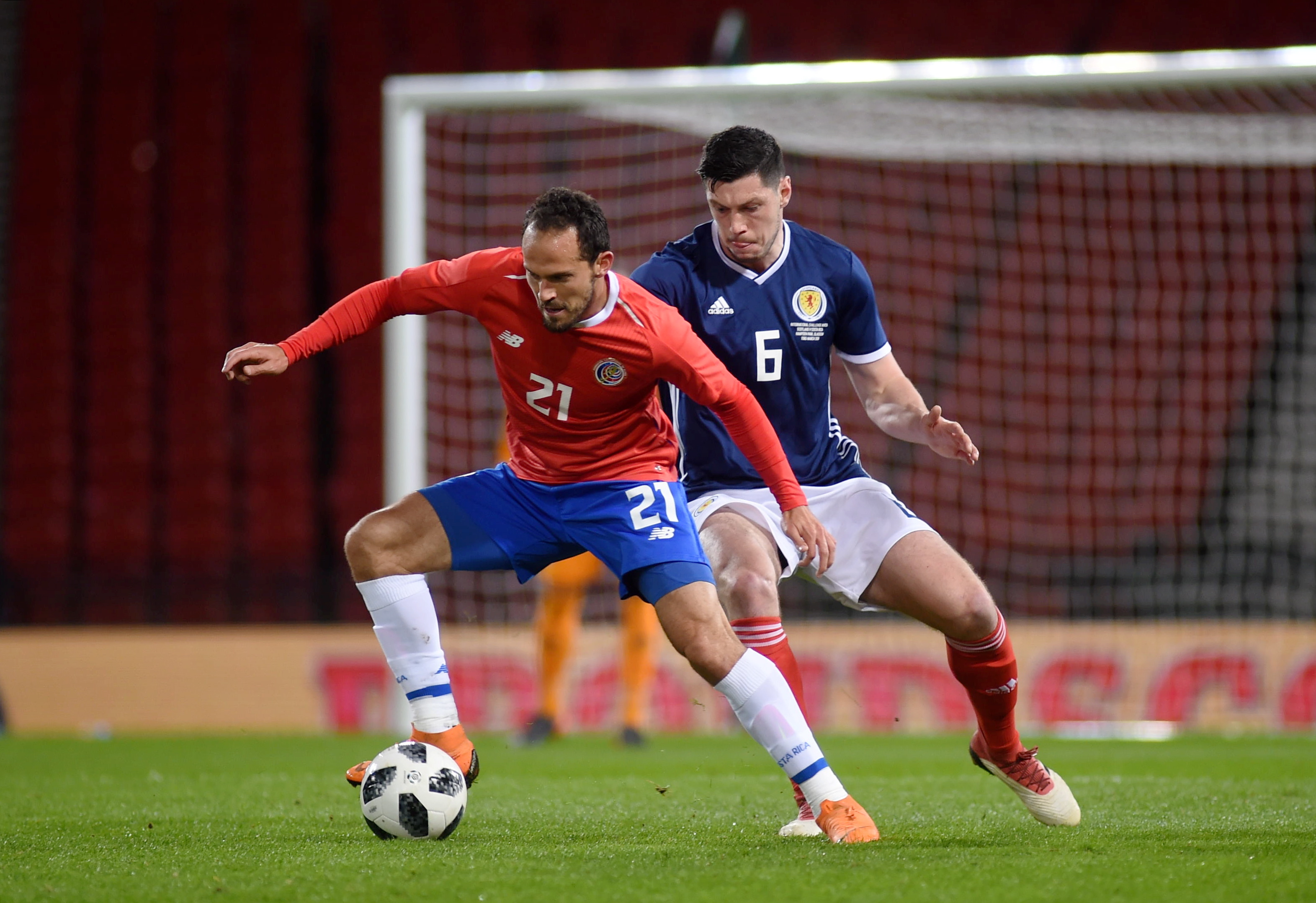 Costa Rica's Marcos Urena and Scotland's Scott McKenna. Picture by Darrell Benns