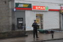 Police outside the store this morning.