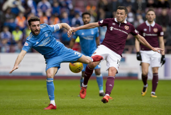 Aberdeen's Graeme Shinnie competes with Hearts' Don Cowie.