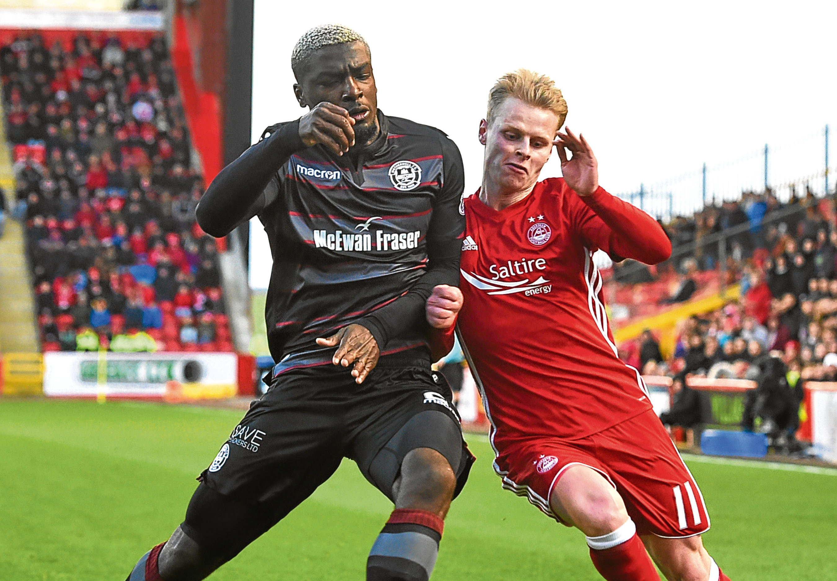 Motherwell's Cedric Kipre and Gary Mackay-Steven in action earlier this term.