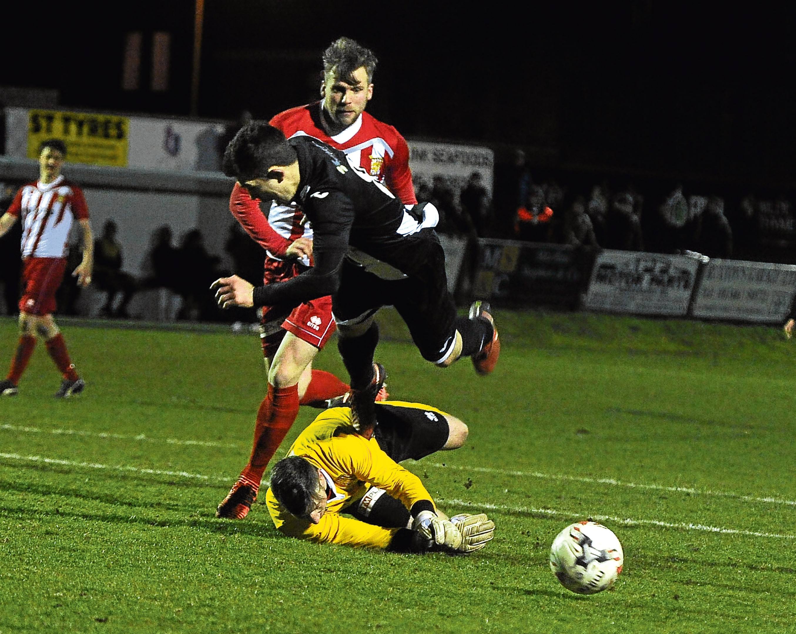 Fraserburgh v Formartine at Bellslea, Fraserburgh: In the picture William West  is sent flying by keeper Kevin Main for a penalty for Fraserburgh.