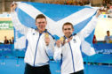 Scotland's Neil Fachie (right) and pilot Matt Rotherham celebrate with their gold medals after winning the Men's B&VI 1000m Time Trial at the Anna Meares Velodrome during day one of the 2018 Commonwealth Games in the Gold Coast, Australia.