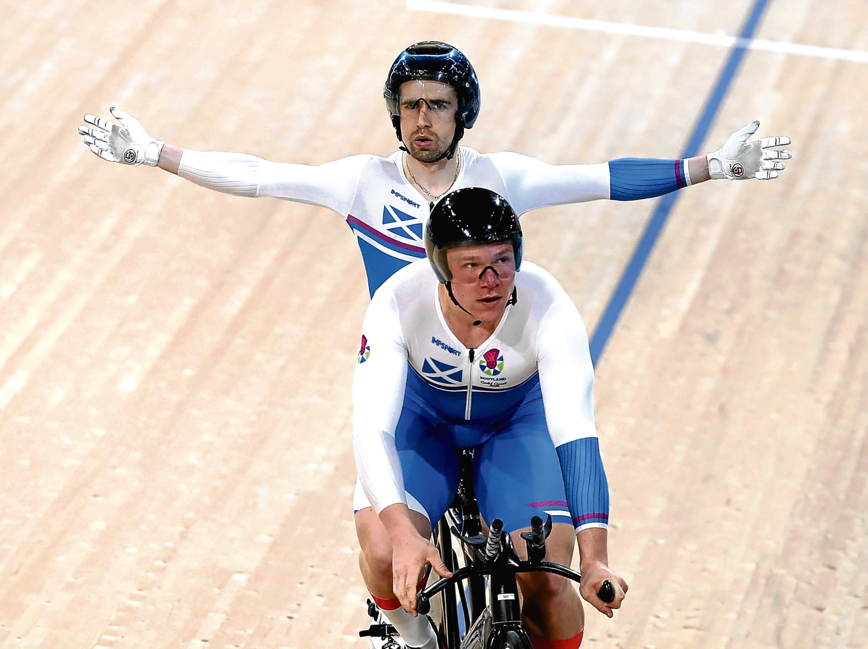 Neil Fachie of Scotland and pilot Matt Rotherham celebrate winning gold in the Men's B&VI 1000m Time Trial during the Cycling on day one of the Gold Coast 2018 Commonwealth Games at Anna Meares Velodrome.