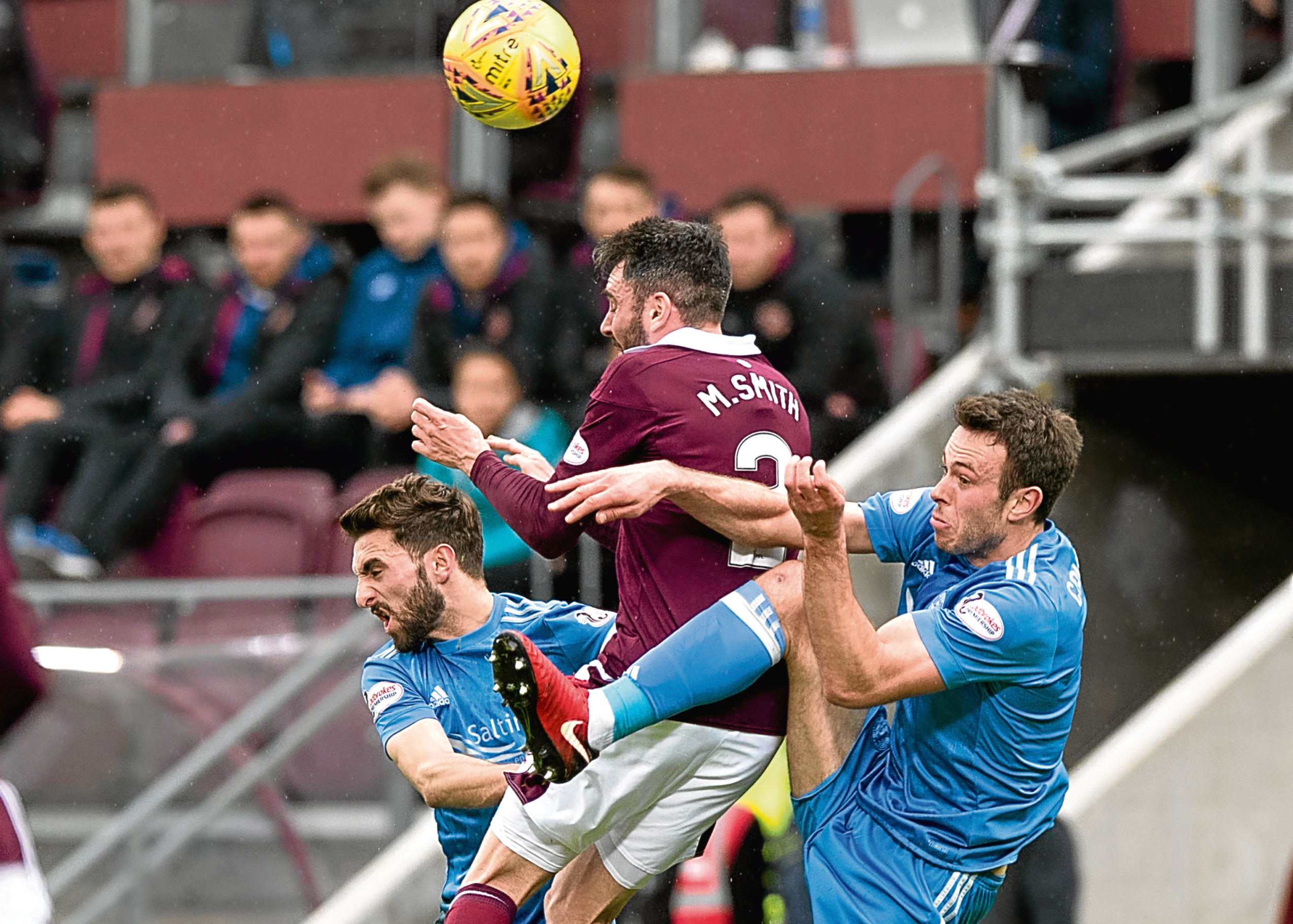 Aberdeen's Andrew Considine competes with Hearts' Michael Smith and Graeme Shinnie.