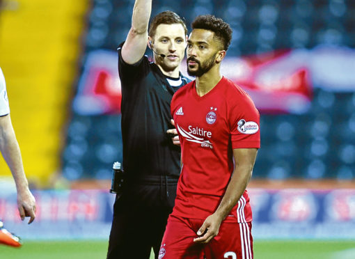Aberdeen's Shay Logan getting booked against Kilmarnock in the quarter-finals.