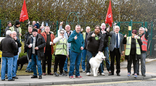 First Aberdeen drivers form a picket line on King Street during the strike.
