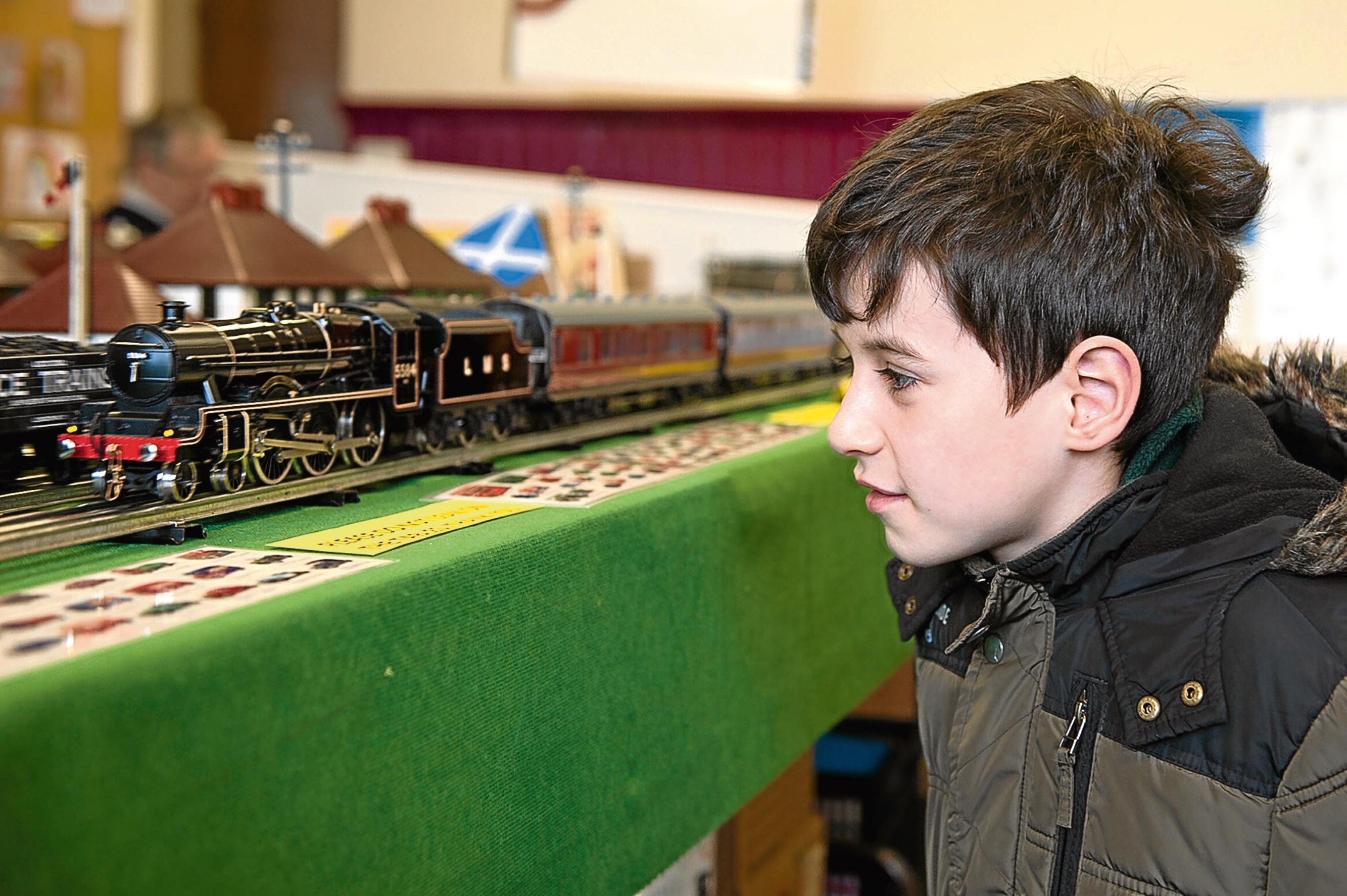 Caption (description) CR0000444,Kirriemuir Miniature railway exhibition, Picture shows, Visitor Arran Joss looking at the trains, 7th April 2018