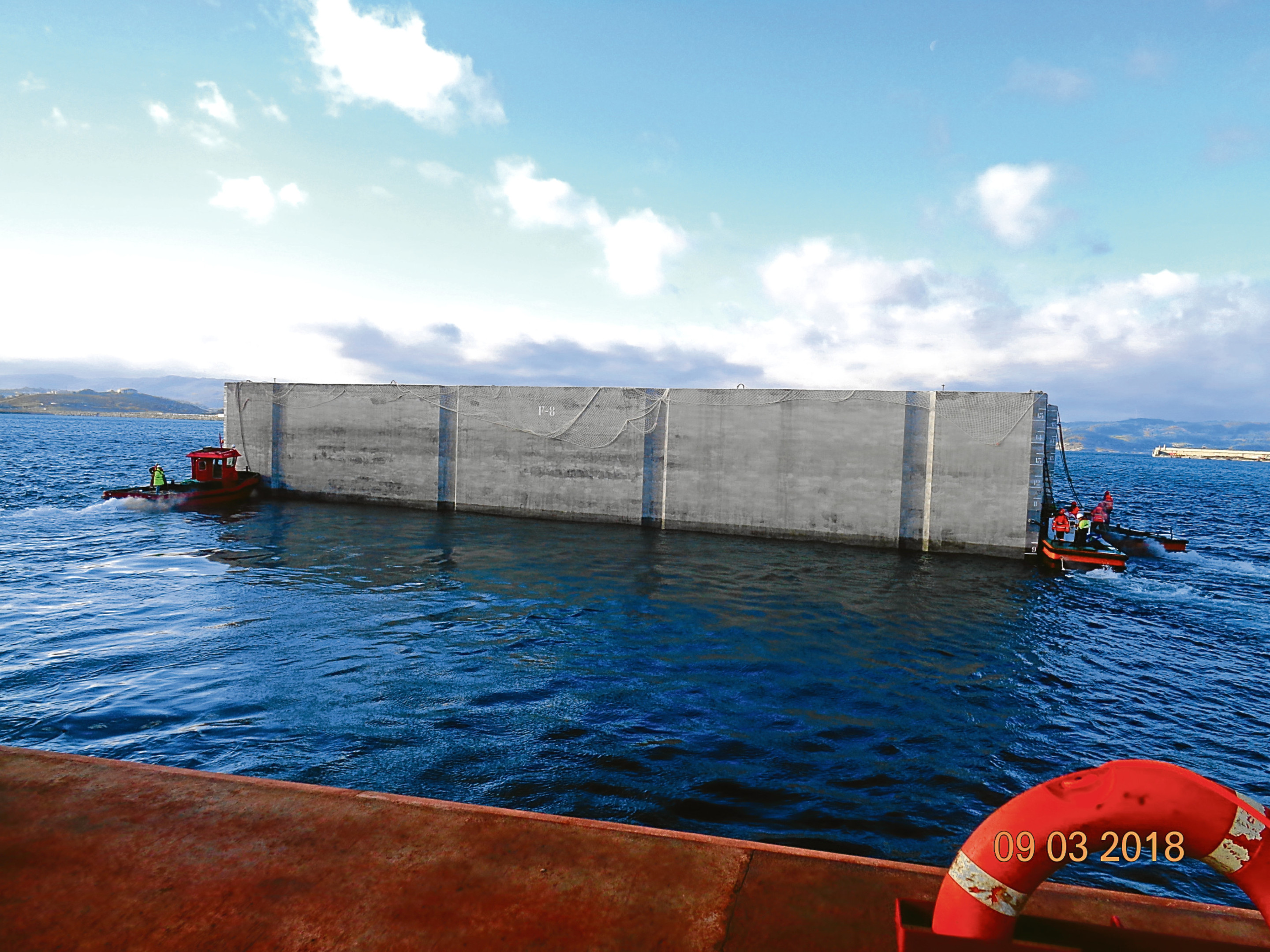 A caisson unit, being manufactured in Spain, will be floated into place at the harbour.