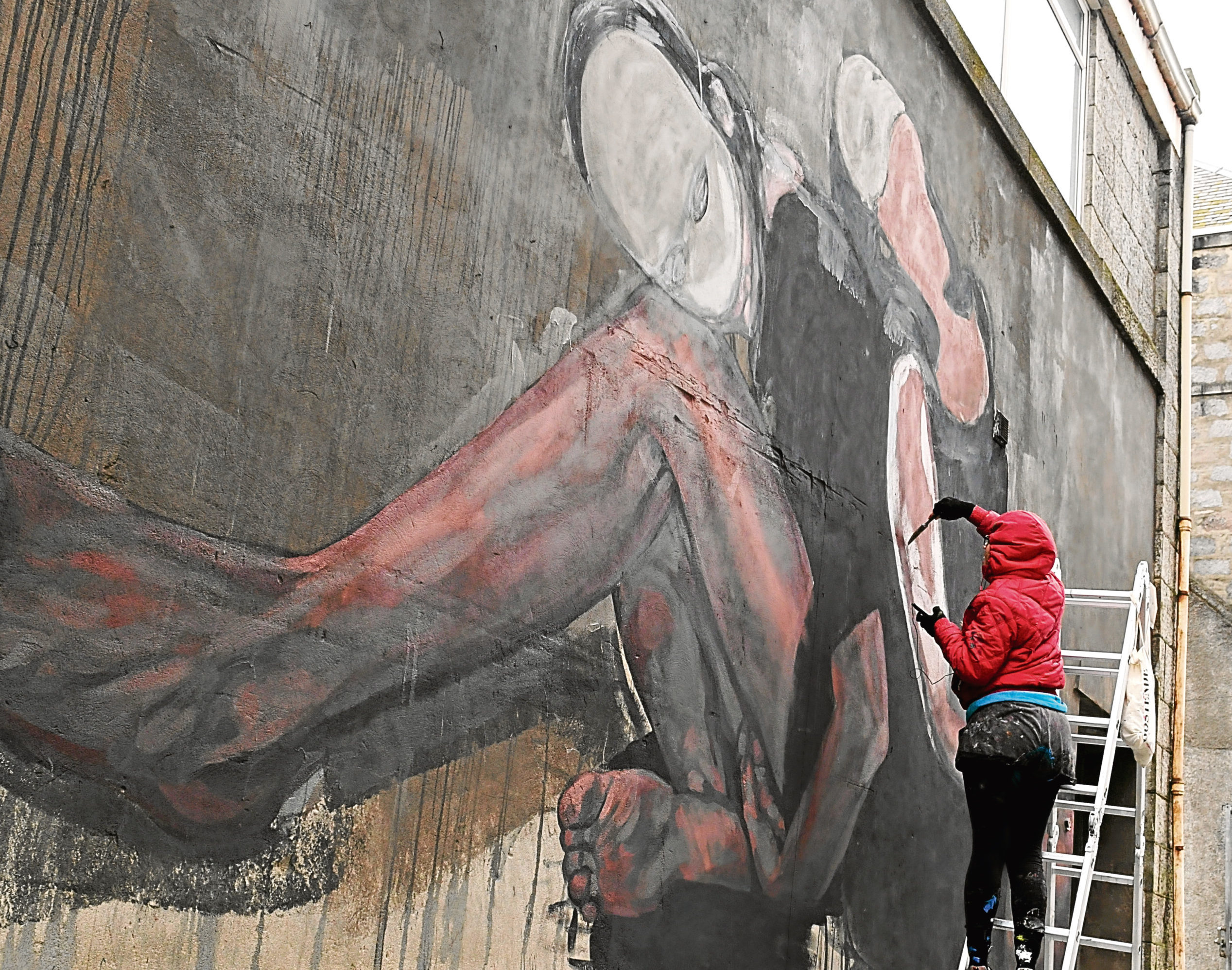 Artists begin working on a Nuart piece on Union Row