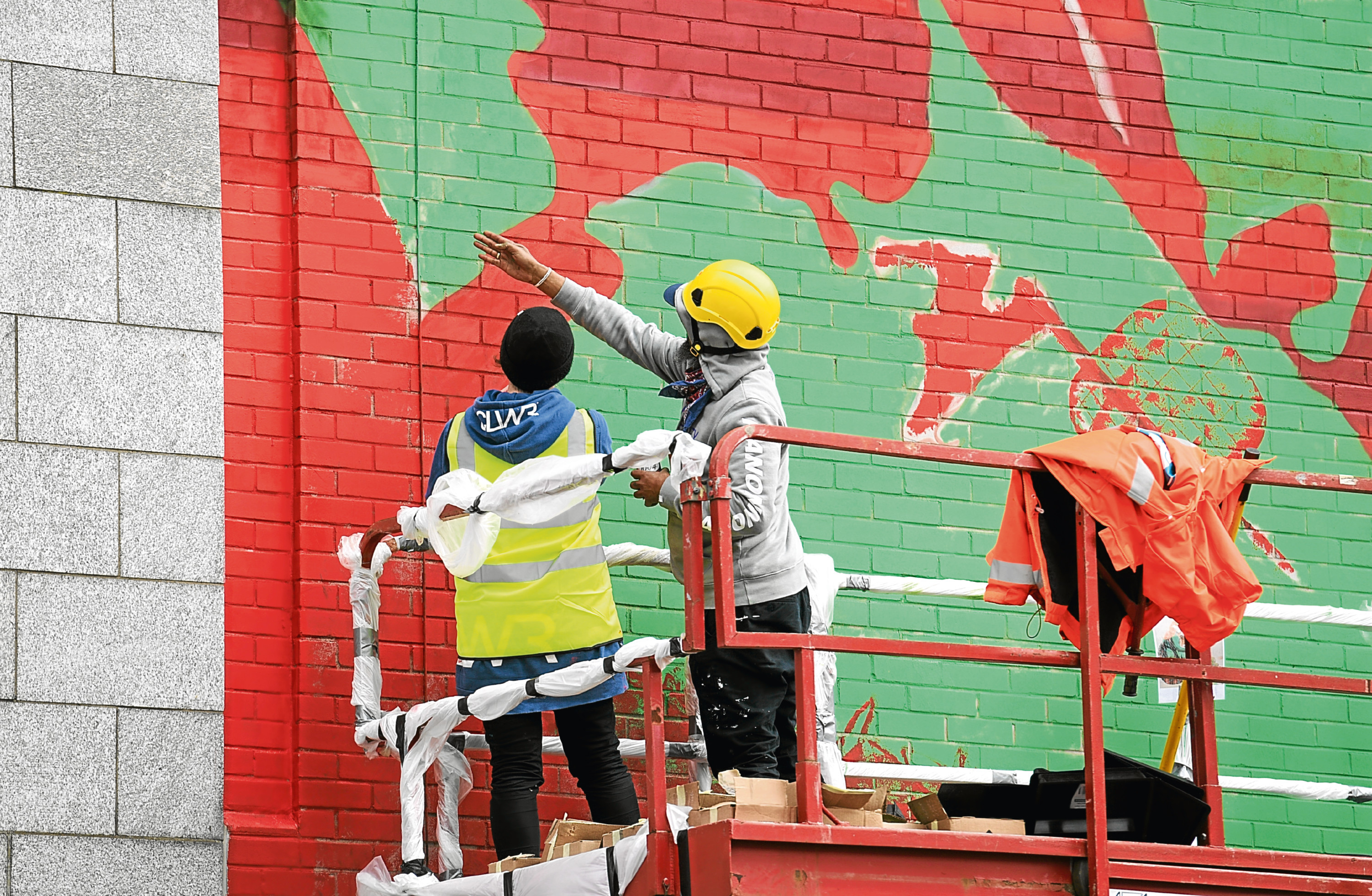 Artists Numi and RH74  working on their piece on Union Row.