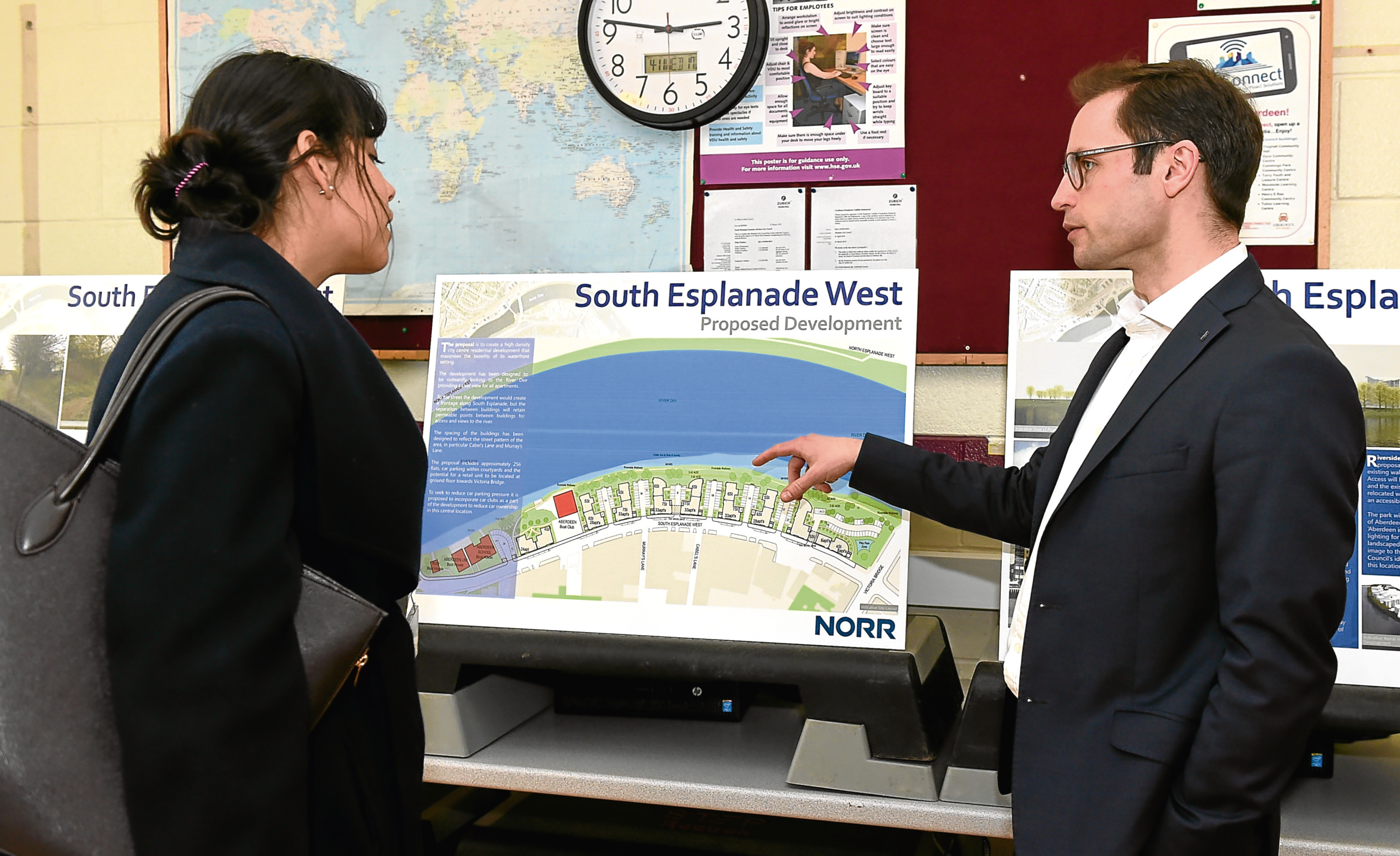EE reporter Ana Da Silva and Daniel Harrington, head of planning at Norr, study the plans.