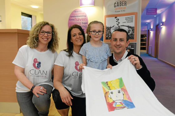 Lorna Cutress,Haven team leader, Stacy Edghill, Indee Calder-Leask with the T-shirt she designed, and Findlay Leask.