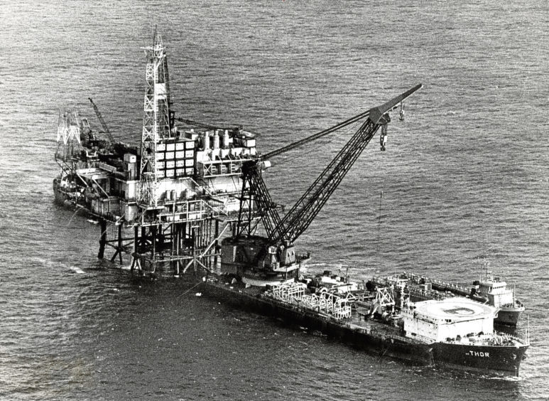 1976: BP Forties' FC platform with the giant crane barge Thor and a supporting supply vessel.