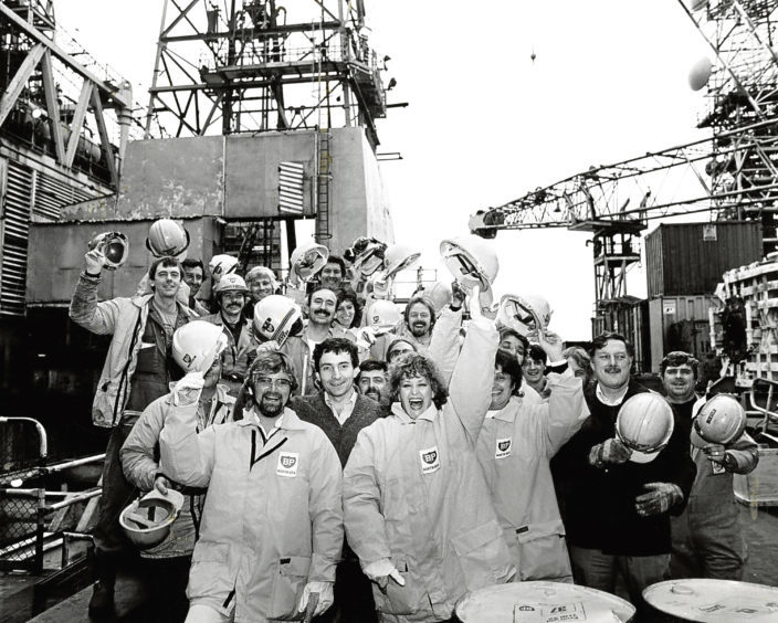 1984: Workers on BP's Forties Alpha production platform are joined by celebrities Noel Edmonds and Barbara Dickson.