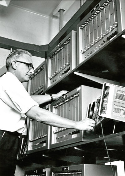 1971: Mr K Foster at Stonehaven Radio Station checks the signal strength of messages coming from the oil rigs by teleprinter.