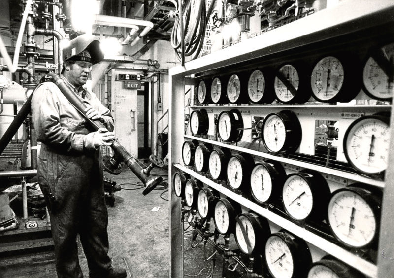 1982: Mr S Rennick of Blandford Offshore fits pipes in the gas compression room.