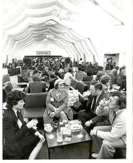 1975: some visitors taking it easy at the Oil Offshore exhibition.