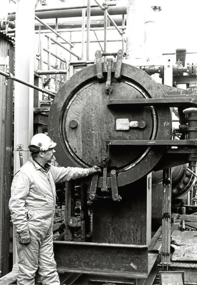 1982: Neil Anderson, offshore installation manager, inspects the pipe end.
