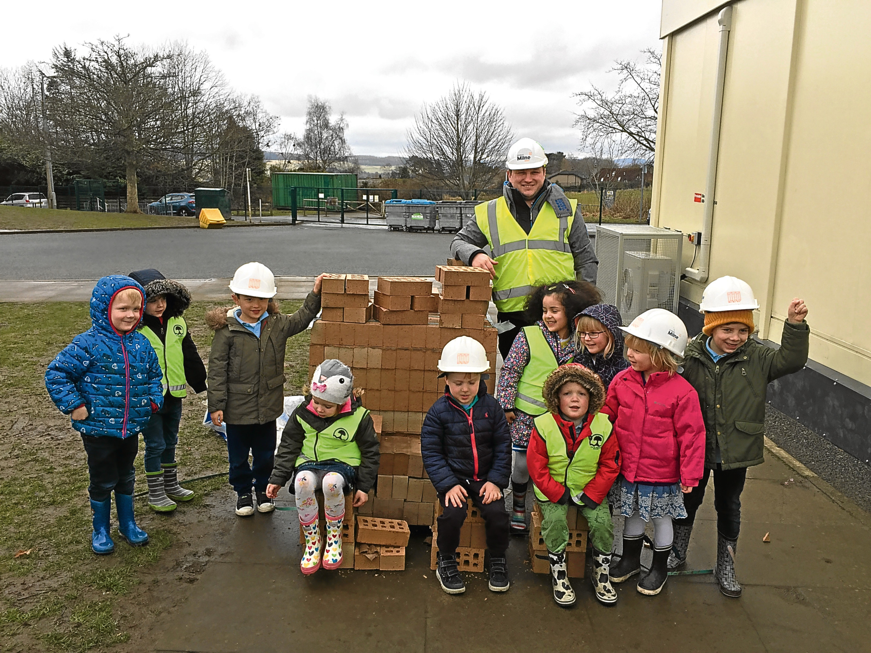 Children from Cults nursery with the delivery from Stewart Milne.