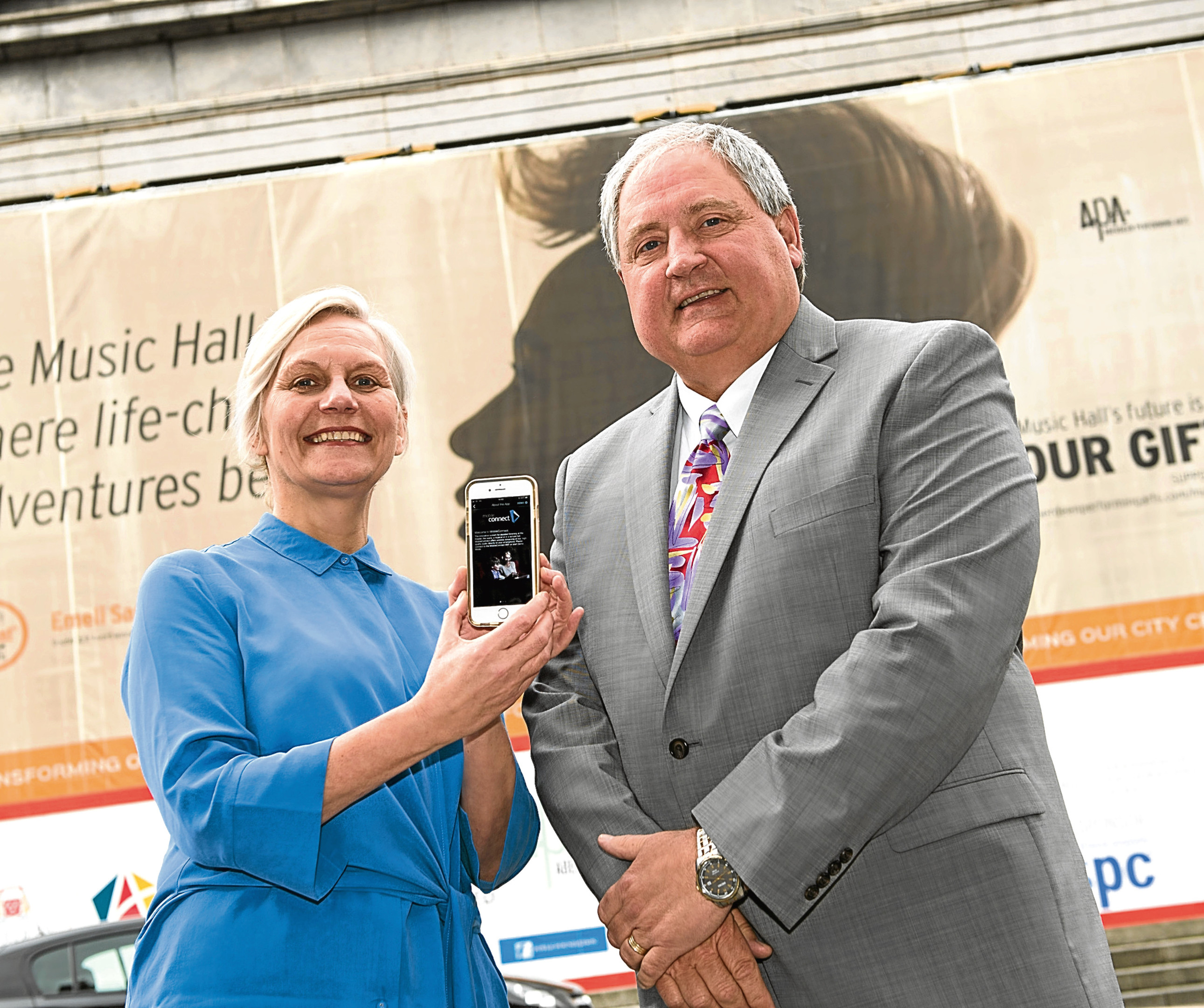 Money provided by Music Hall Sponsor Apache for Hearing Loop. Pictured is Jane Spiers, Chief Executive at Aberdeen Performing Arts with Music Hall Sponsor Apache's Region Vice President  and Managing  Director, John Graham.
