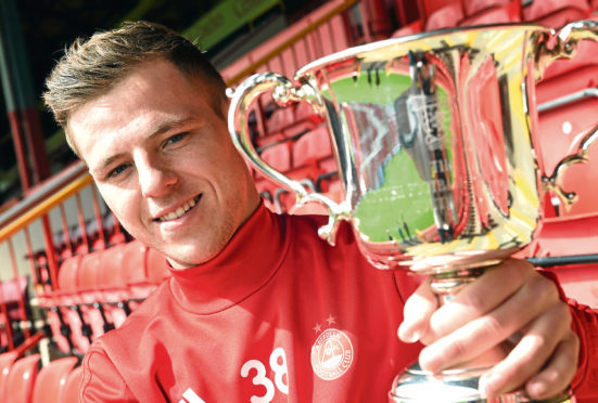 Bruce Anderson at Pittodrie with the Scottish FA Youth Cup ahead of Thursday's Cup Final. Picture by Darrell Benns