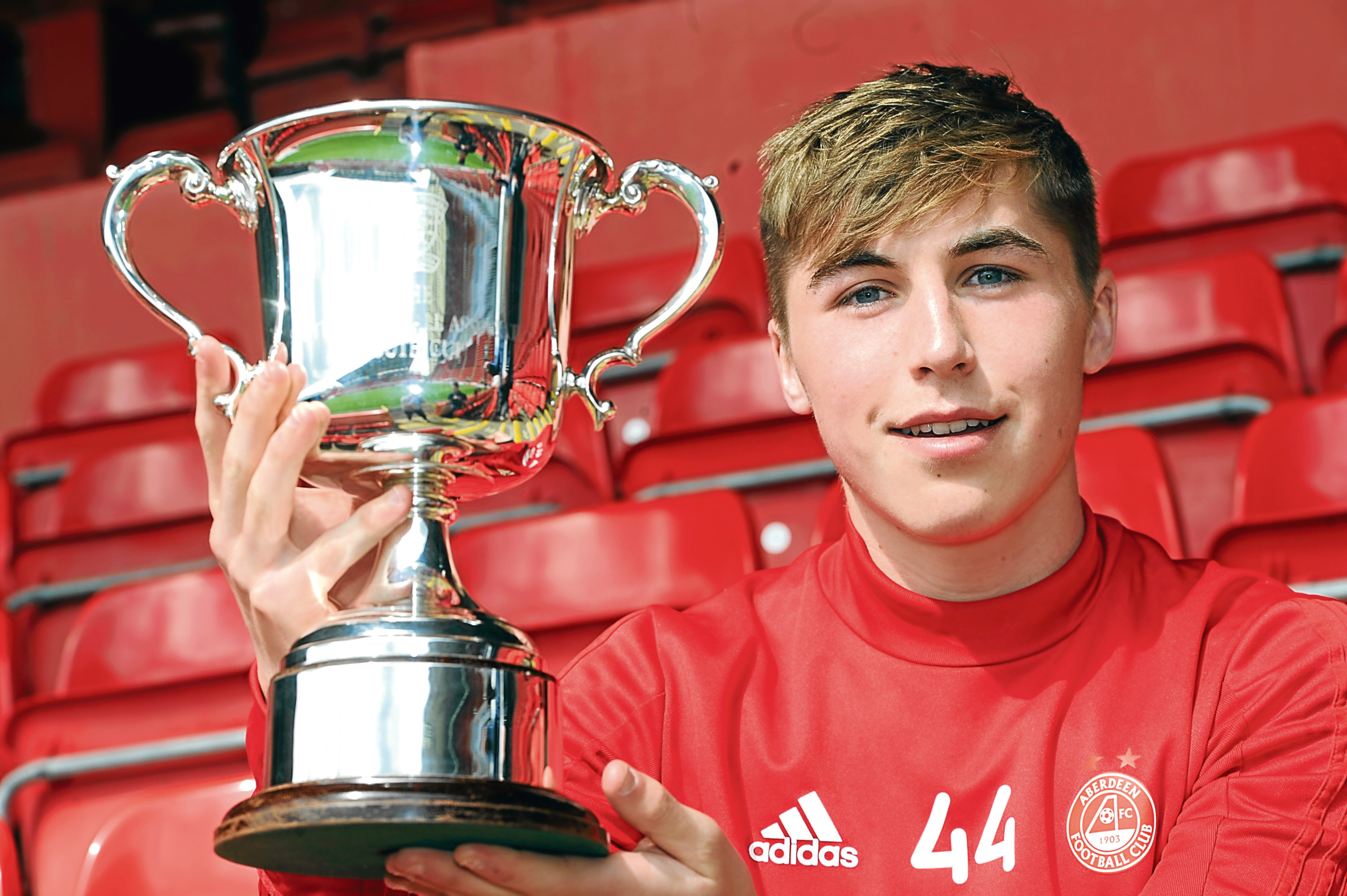 Pictured is Aberdeen Football Club's Dean Campbell at Pittodrie with the Scottish FA Youth Cup ahead of Thursday's Cup Final. Picture by DARRELL BENNS     Pictured on 24/04/2018
