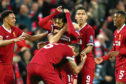 Mo Salah with his team mates during the UEFA Champions League Semi Final First Leg match between Liverpool and A.S. Roma at Anfield.