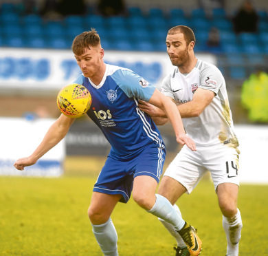 Peterhead's  Rory McAllister and Montroses Sean Dillon Pic by Chris Sumner Taken 3/2/18