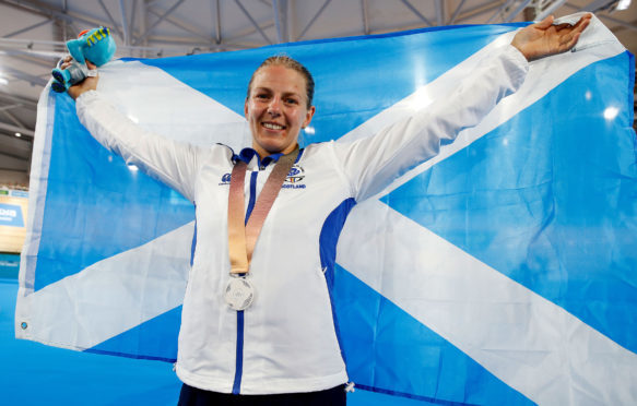 Scotland's Neah Evans celebrates with her silver medal.