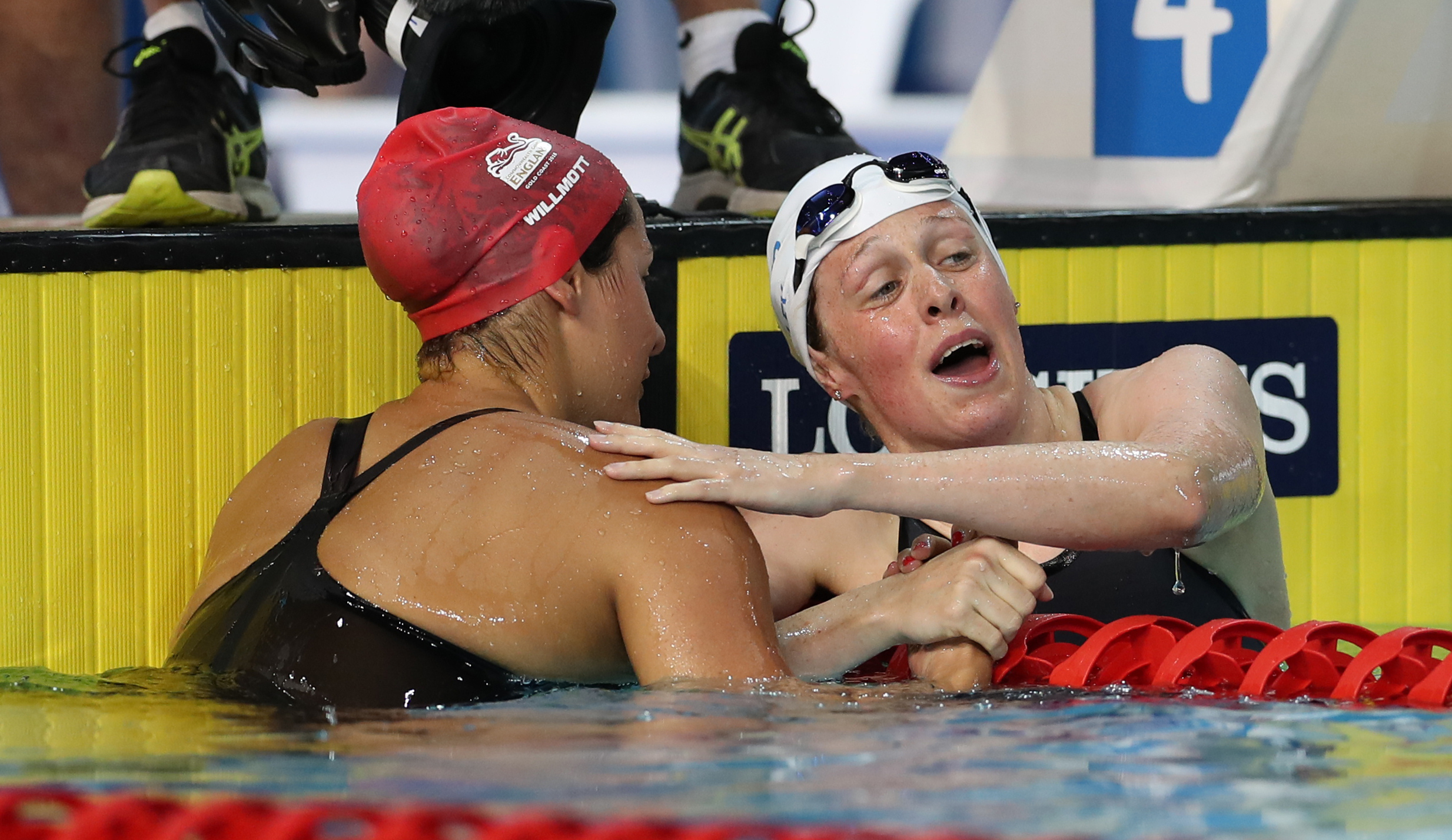England's Aimee Willmott, left, after winning Gold and Scotland's Hannah Miley who won Silver in the Women's 400m Individual Medley at the Optus Aquatic Centre during day one of the 2018 Commonwealth Games in the Gold Coast, Australia.