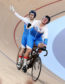 Scotland's Neil Fachie (left) and pilot Matt Rotherham (right) celebrate winning gold in the Men's B&VI Sprint Finals - Gold at the Anna Meares Velodrome during day Three of the 2018 Commonwealth Games in the Gold Coast, Australia. Photo: Martin Rickett/PA Wire.