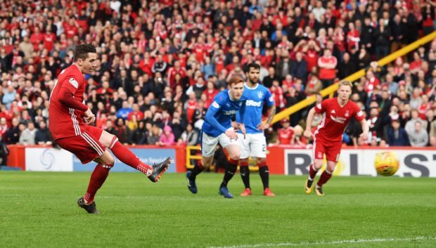 Aberdeen's Kenny McLean scores a penalty to make it 1-0.