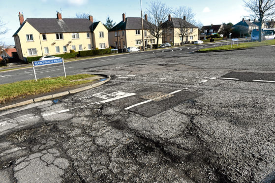 Potholes on the city's Provost Rust Drive at its junction with Marchburn Road.