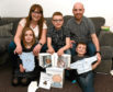 Darren Hamilton-Hall, centre, is surrounded by his family, from left, Anna, 8, mum Hazel, dad Corey and brother Callen, 4