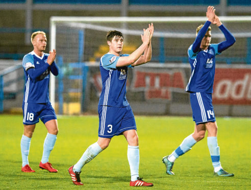 Peterhead's Mason Robertson, middle, celebrates at full-time.