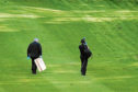 Police hunt for clues at the golf course