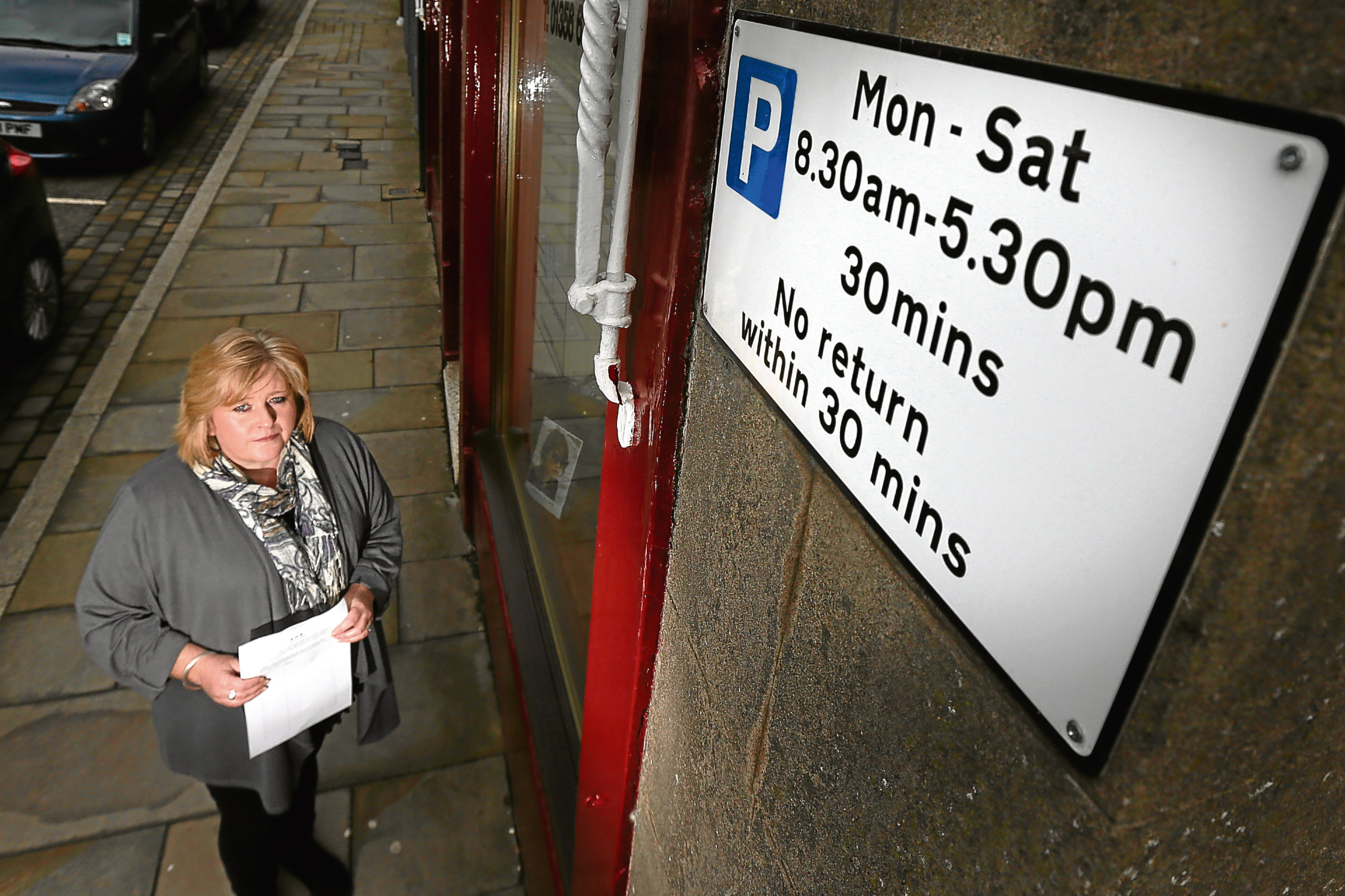 Courier News. Graham Brown story. CR0000245 A petition launched by Brechin woman Jill Scott gathers pace against proposed Angus parking charges over fears burghs will become 'tumbleweed towns'. Pic shows; Jill Scott in Brechin High Street, with her petition against proposed parking charges. Wednesday, 28th March, 2018.