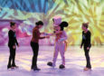 AECC. Ana Da Silva learning to skate with Disney on Ice performers, from left, Alisha Conley and Agota Zakany, along with Mickey Mouse. 03/05/18. Picture by KATH FLANNERY