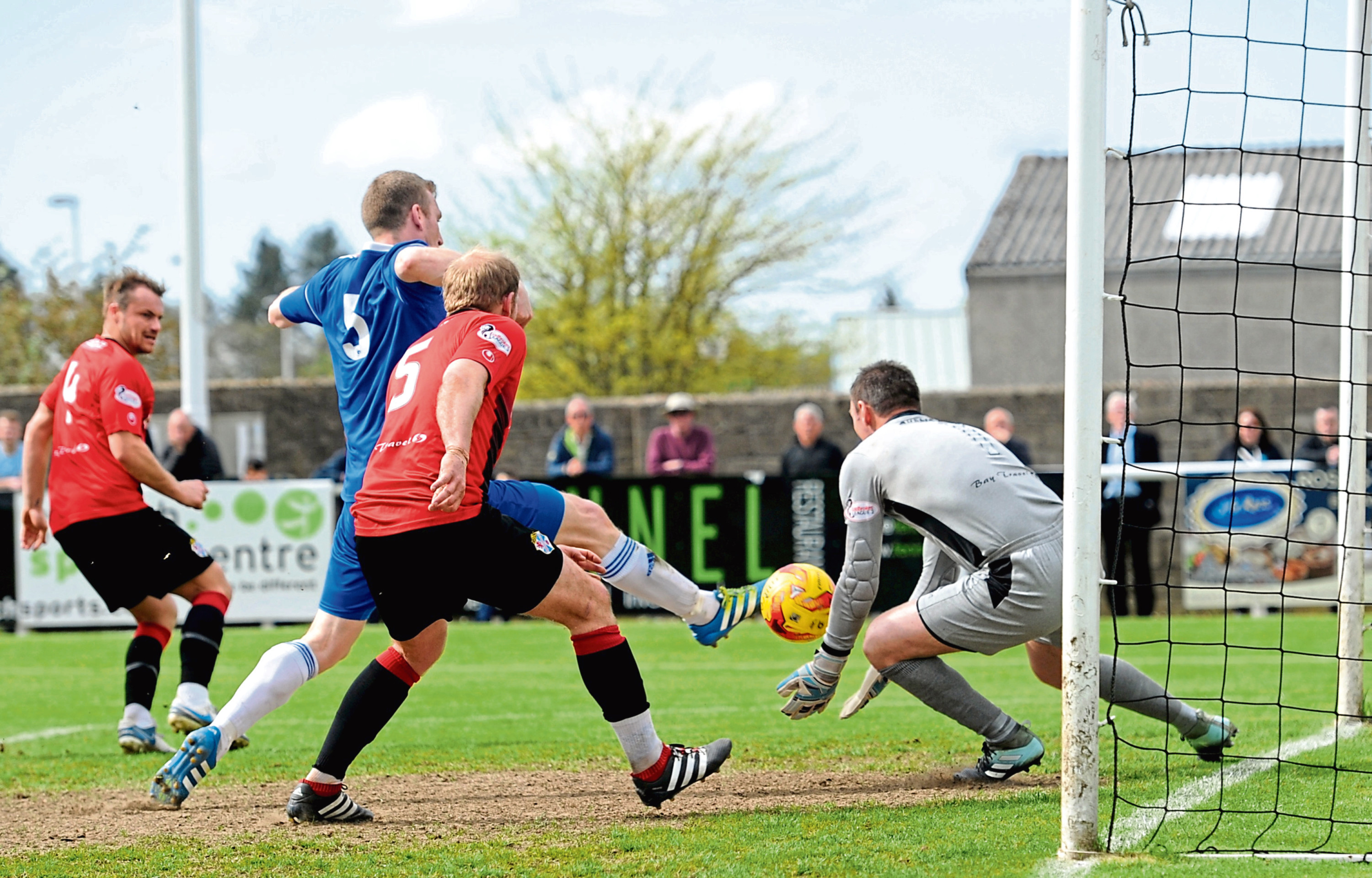Cove's Eric Watson and Cowdenbeath's Bryan Gilfillan compete near the Blue Brazil's goal.
