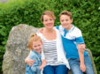 Suzanne Davies and her children Lauren and Max.