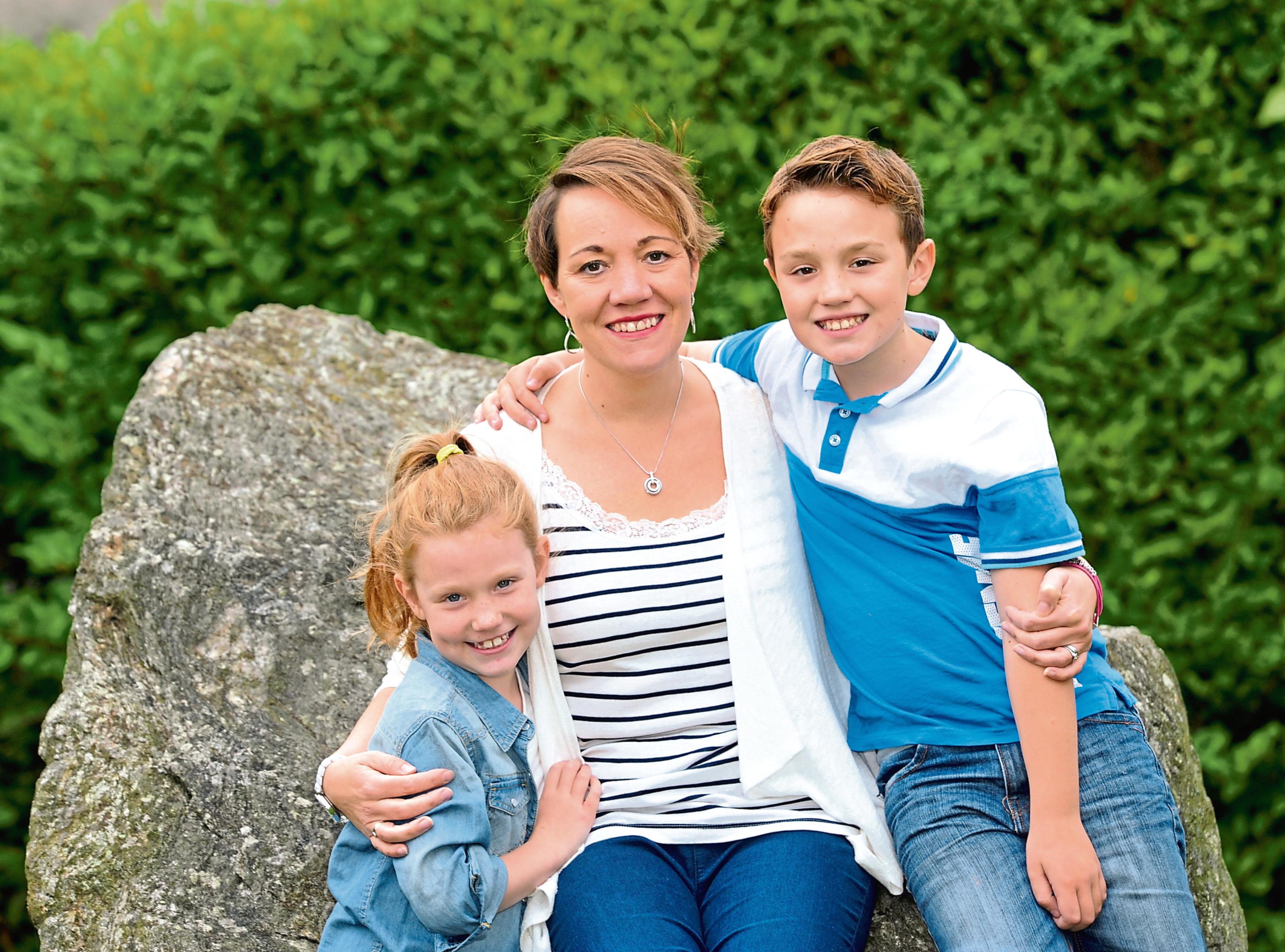 Suzanne Davies and her children Lauren and Max.
