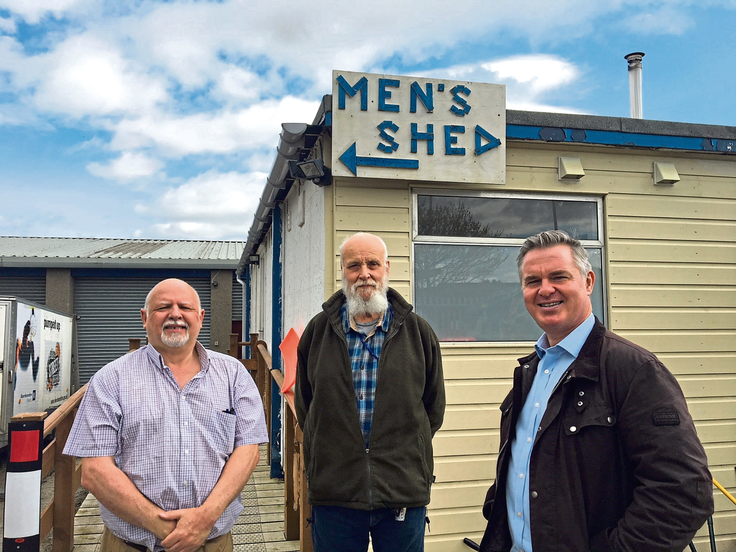 Archie Peebles and Leith Robertson from Inverurie Men's Shed with Gordon MP Colin Clark.