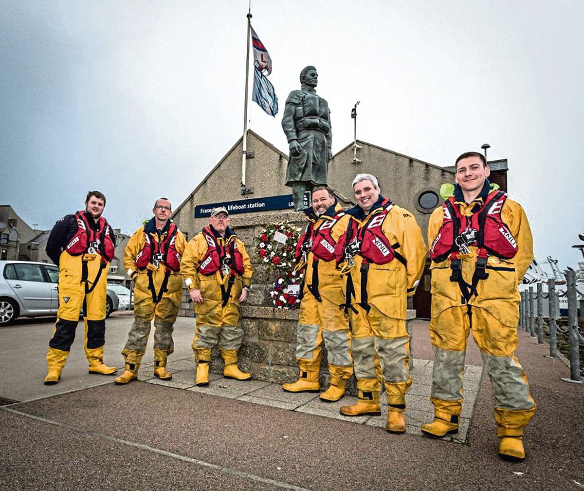 Grant Morrison, Dave Sutherland, Victor Sutherland, Craig Brockette, John Stephen and AJ Morgan at the memorial statue in Fraserburgh.