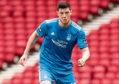 Scott McKenna in action for Aberdeen.