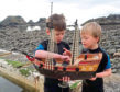 Brothers Ollie Ferguson, eight, and Harry Ferguson, five, initially launched their Playmobil boat into the waters off Rosehearty at the end of May