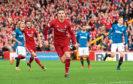 Kenny McLean celebrates a goal for Aberdeen.