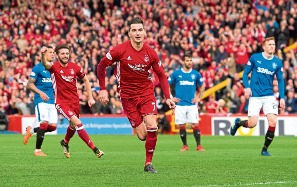 Kenny McLean celebrates a goal for Aberdeen.