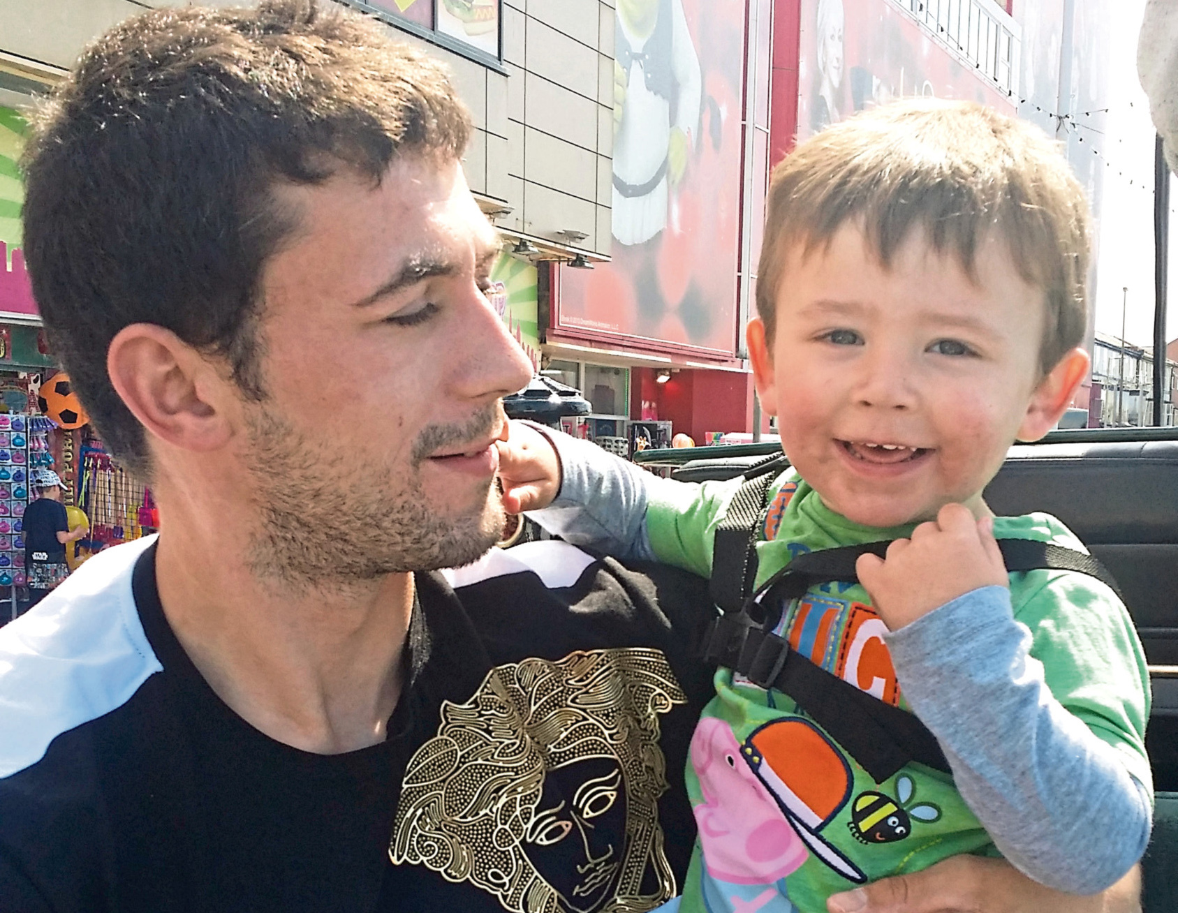 Robert Reid, picturedwith his son, died after being attacked by his friend Darren Riley
